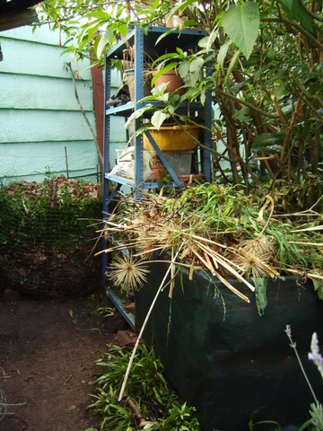 Home made compost holding bin and leaf bin